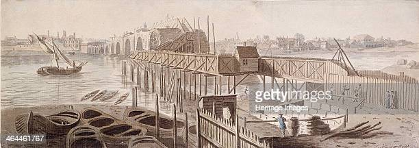 View of a partially built Blackfriars Bridge London c1762 with boats on the bank of the River Thames