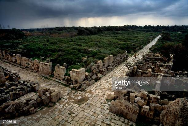 A view of a paved intersection of the ancient Roman roads in Leptis Magna the largest city of the ancient region of Tripolitania May 2000 in Leptis...