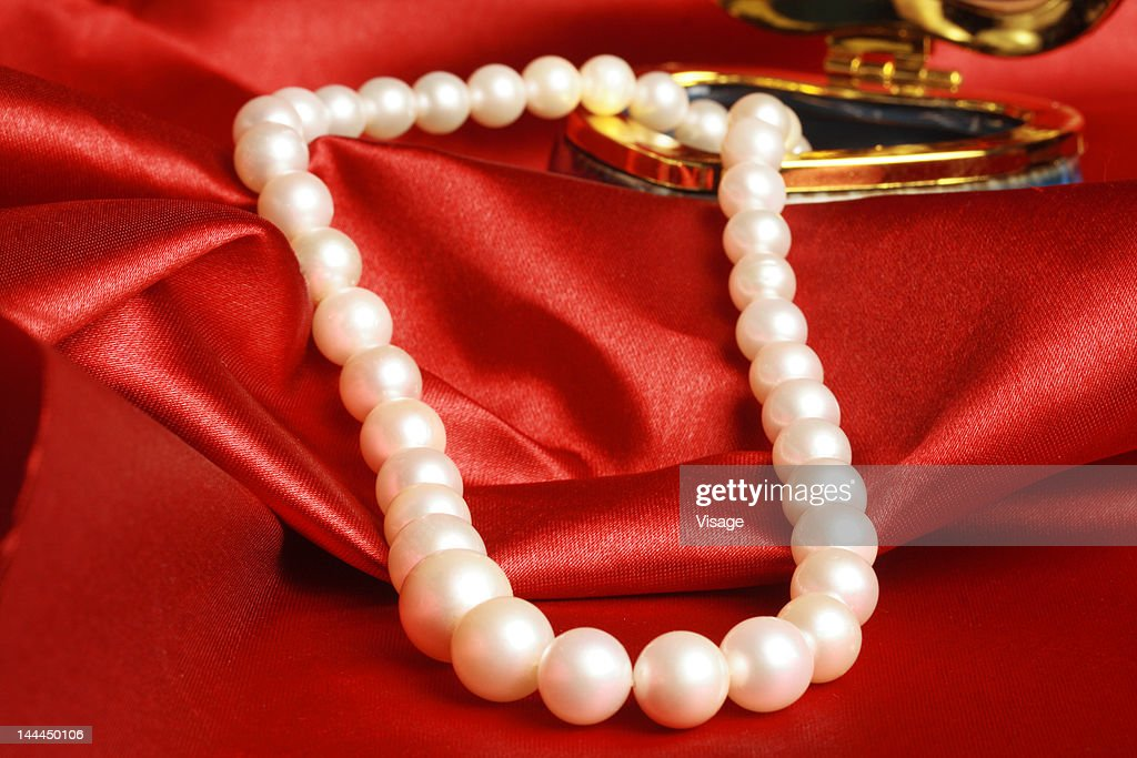 View Of A Pearl Necklace And Jewellery Box On A Satin Cloth Stock ...