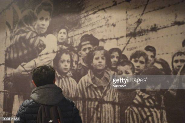 A view of a person visiting a permanent exhibition inside the Auschwitz 1 camp seen just a few days ahead of the 73rd anniversary of the liberation...