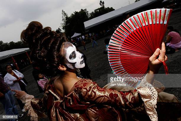 View of a person wearing skeleton makeup as part of an Ofrenda for Diego Rivera at the Anahuacalli Diego Rivera Museum as part of the celebrations of...