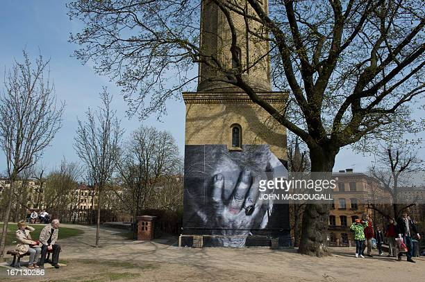 A view of a photograph posted on a wall by French graffiti artist and selfcoined photograffeur JR is pictured in Berlin on April 21 2013 The artist...
