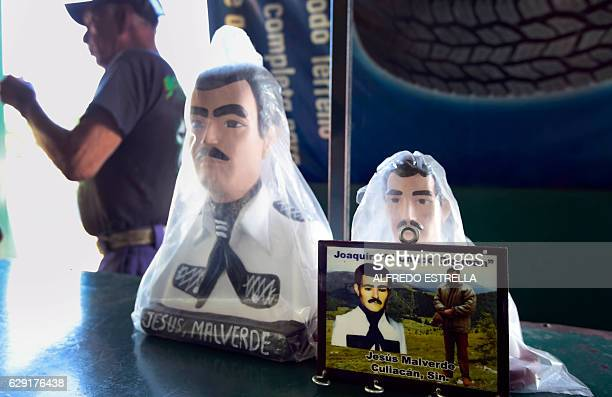 View of a picture depicting Mexican drug lord Joaquin Guzman aka El Chapo and narcosaint Jesus Malverde who according to legend was a Robin Hoodtype...