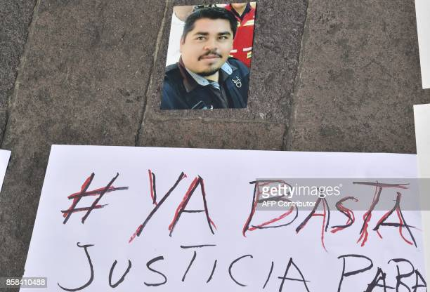 View of a picture of slain Mexican photojournalist Edgar Daniel Castro displayed in front of the government's palace during a demonstration to demand...