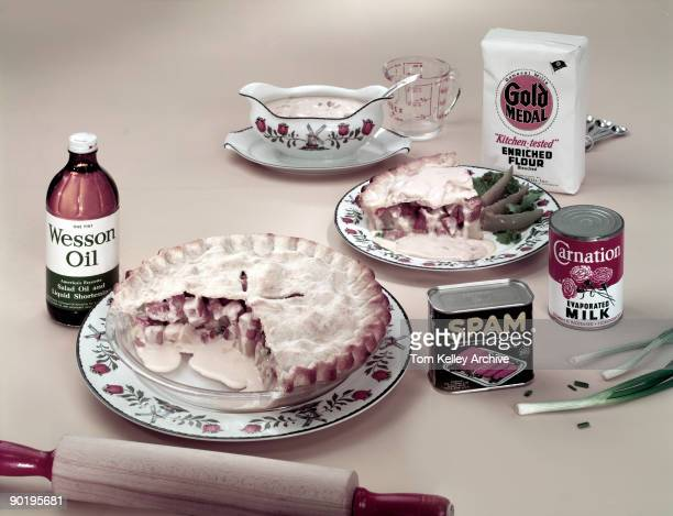 View of a pie made with Spambrand canned meat potatoes scallions and cream of mushroom soup among other ingredients some of which are pictured along...