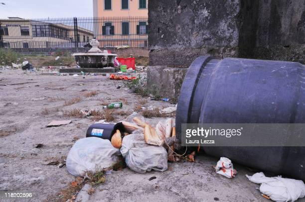 A view of a pile of uncollected rubbish in the promenade on July 4 2011 in Naples Italy Italy's third largest city is once again experiencing a...