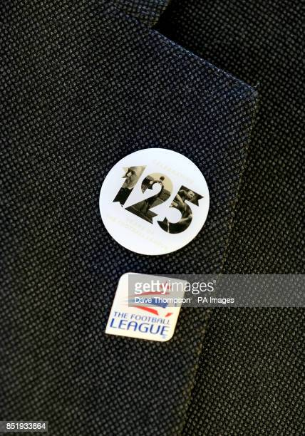 A view of a pin badge marking the 125th anniversary of the football league and Football League pin badge on a jacket