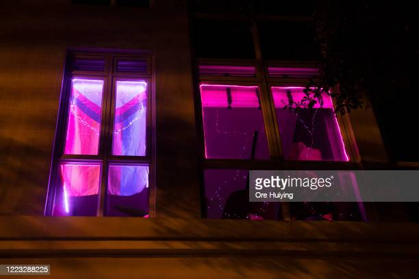 A view of a pink light displaying in a house in a show of support to the LGBTQ community on June 27 2020 in Singapore Due to the ongoing coronavirus...