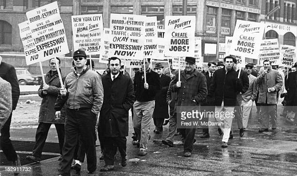 View of a placardholders at a pro'Lower Manhattan Expressway' also known as the 'Broome Street Expressway' demonstration near the intersection of...