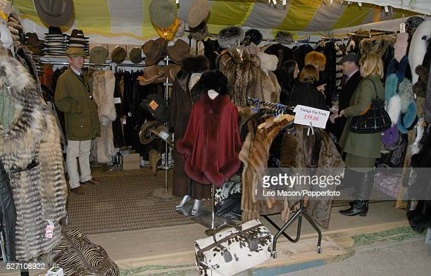 View of a pop up shop selling tweed jackets fur coats and caps during the 2012 Cheltenham National Hunt Festival at Cheltenham racecourse in...