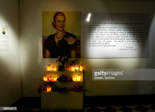 View of a portrait of Eva Duarte de Peron Evita with lit cadles displayed at the main hall of the Evita Museum in Buenos Aires on May 16 2013 The...