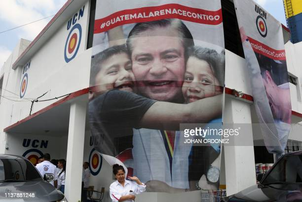 View of a poster of Guatemala's presidential candidate for the Union del Cambio Nacional party Mario Estrada who was arrested in Miami along with...