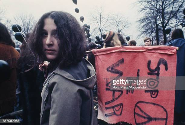 View of a protester holding a 'Stop The War' flag at an antiVietnam War demonstration outside the 1968 Democratic National Convention at the...