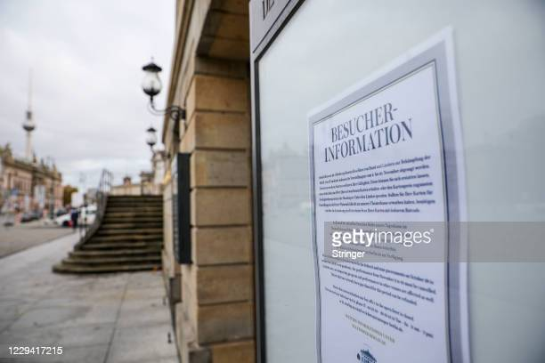 View of a public notice at the closed Berlin State Opera on the first day of a four-week semi-lockdown during the second wave of the coronavirus...