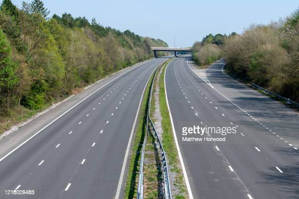 View of a quiet M4 motorway at Bridgend on April 10, 2020 in Bridgend, United Kingdom. Police have stepped up patrols to prevent people from...
