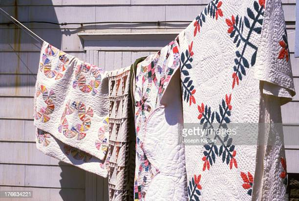 View of a quilt as it hangs on a line outside a home Everett Pennsylvania 1974