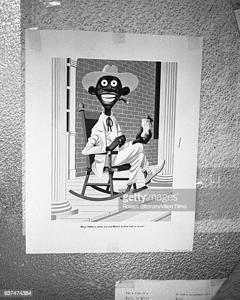 View of a racially stereotyped poster on a wall in City Hall Greenwood Mississippi 1964 The poster which reads 'Now THIS is what me and Martin Luther...