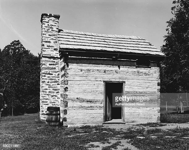 A reconstruction of the childhood home of educator and author Booker T Washington a crude log cabin on the Burroughs' Plantation in the Blue Ridge...
