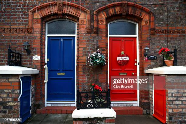 A view of a red and a blue front door outside the stadium during the Premier League match between Liverpool FC and Everton FC at Anfield on December...