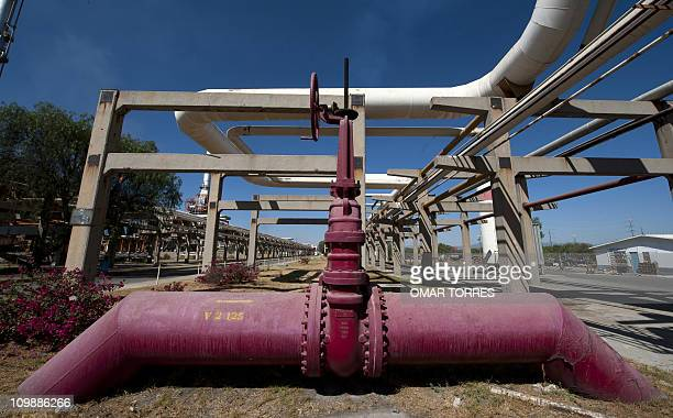 View of a red pipe line which transports water to be used in case of fire and its valve at Mexican stateowned petroleum company PEMEX refinery in...