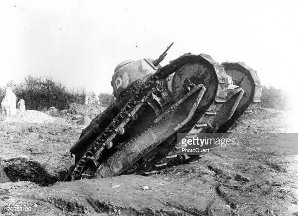 View of a Renault tank crawling out of a shell hole in the field of the 1st Tank Brigade repair and salvage park at Varennes France October 29 1918