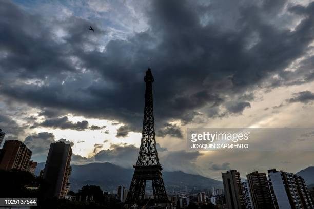 TOPSHOT View of a replica of the Eiffel Tower built within a residential real estate project inspired in Paris in Sabaneta near Medellin Colombia on...
