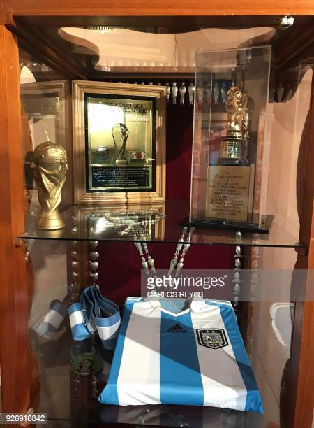 View of a replica of the FIFA World Cup trophy and the Argentinian national football team jersey at the museum of the Virgin of Copacabana del Abra...