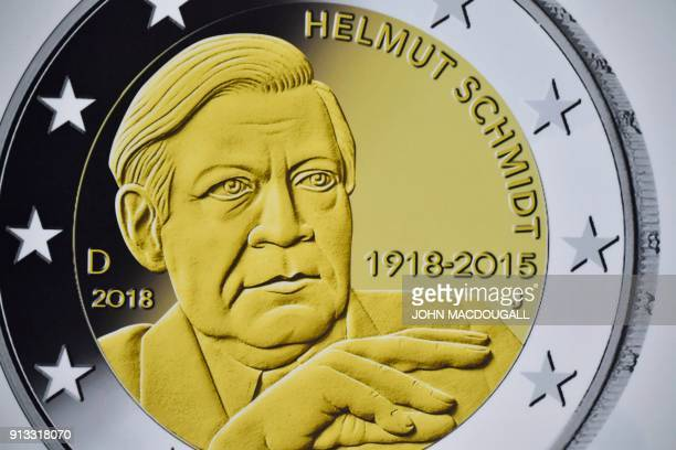 A view of a reproduction of the actual coin featuring Helmut Schmidt is displayed during the presentation of two commemorative 2eurocoins called...