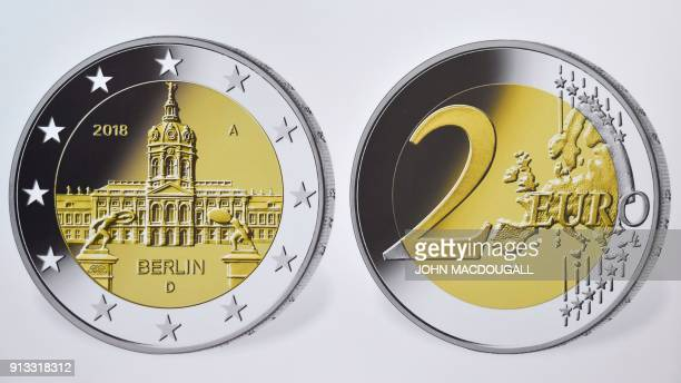 A view of a reproduction of the actual coin featuring the Charlottenburg castle in Berlin is displayed during the presentation of two commemorative...