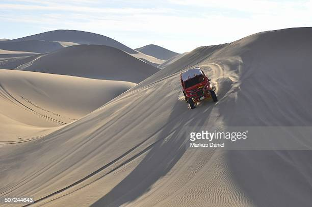 CONTENT] View of a ride in the desert sands near the Huacachina Oasis not far from Ica Peru on a sunny day with clear blue sky Huacachina Oasis is...