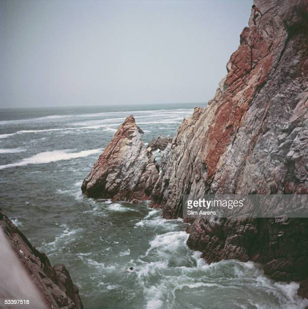 A view of a rocky outcrop on the coast at Acapulco Mexico 1950