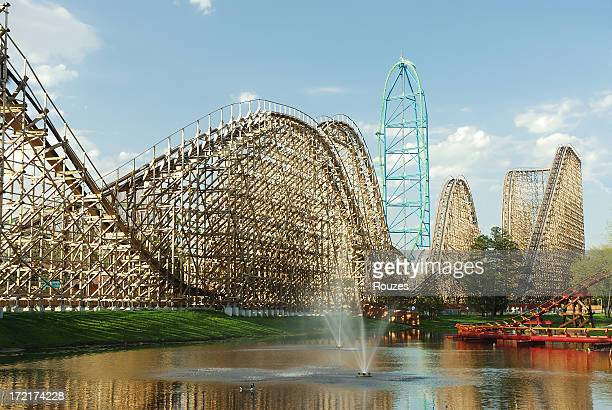 View of a roller coaster park from a man made lake