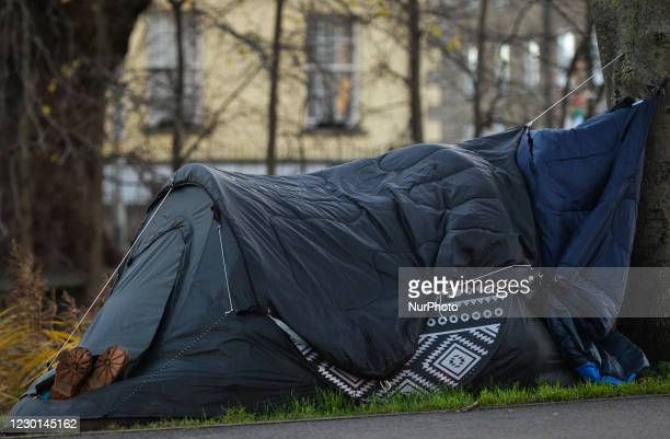 View of a rough sleeper's tent with boots seen sticking out of the tent, next to the Grand Canal in Dublin. As per November 25th, the deaths bring to...