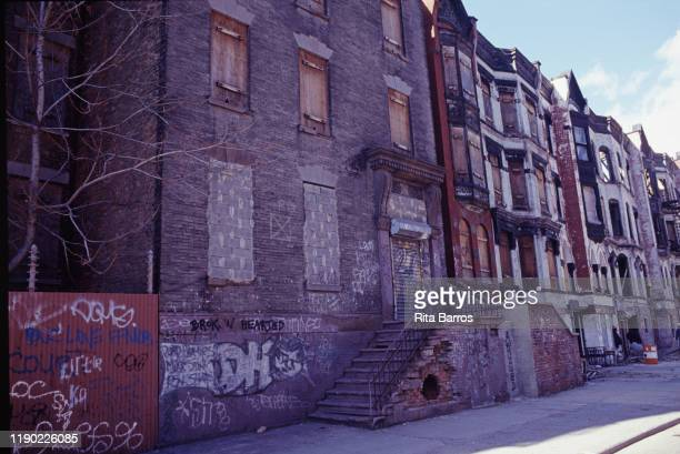 View of a row of abandoned and boarded up buildings Harlem New York New York 1997
