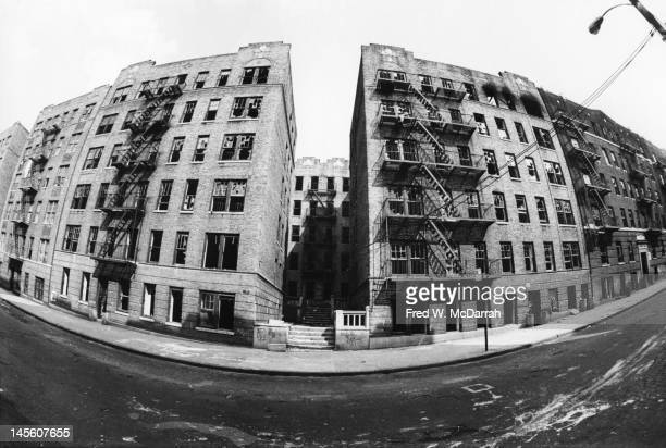 View of a row of abandoned Bronx apartment buildings New York New Yoek June 13 1975