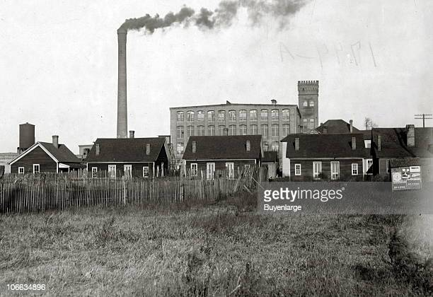 View of a row of clapboard houses part of a row referred to as �Hell's Half Acre� where workers at the nearby mill could purchase the services of...
