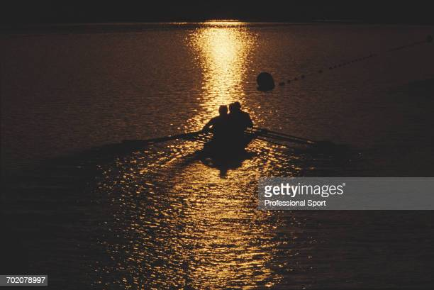 View of a rowing team competing in the quadruple sculls rowing event at the 2000 Summer Olympics at the Sydney International Regatta Centre in Sydney...