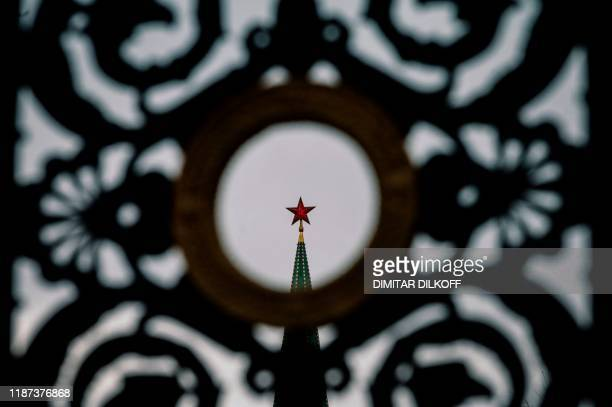 View of a ruby star atop one of the Kremlin's towers in downtown Moscow on December 9, 2019. - Russia will miss next year's Tokyo Olympics and the...