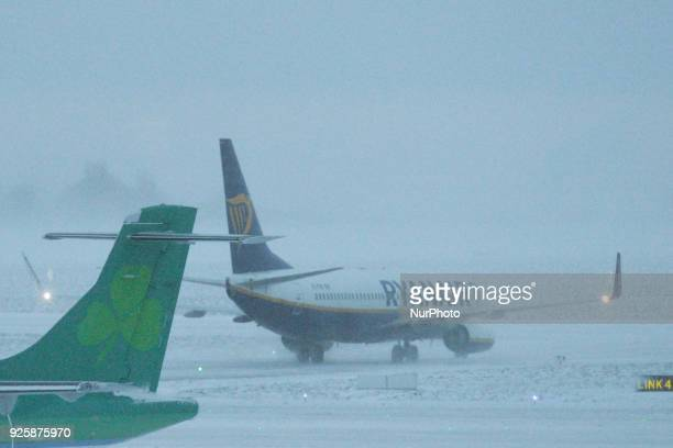 A view of a Ryanair plane on a runway and an Aer Lingus plane parked at Dublin Airport as many flight from and to Dublin airport were cancelled as...