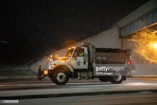 View of a salt truck dropping salt on the icy roadways in Athens, Ohio. Southeastern Ohio was hit by a large snowstorm on Christmas Eve.