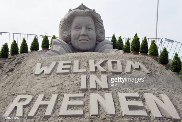 A view of a sand sculpture of Dutch Queen Beatrix with the text 'Welcome in Rhenen' a day before Queens day in Rhenen a day before Queensday on April...