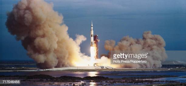 View of a Saturn V rocket blasting off during launch from Kennedy Space Center carrying the Apollo 8 crew of NASA astronauts Commander Frank Borman...