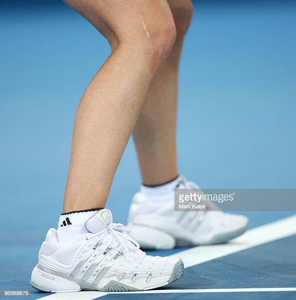A view of a scar on the right knee of Justine Henin of Belgium as she competes in her first round match against Nadia Petrova of Russia during day...