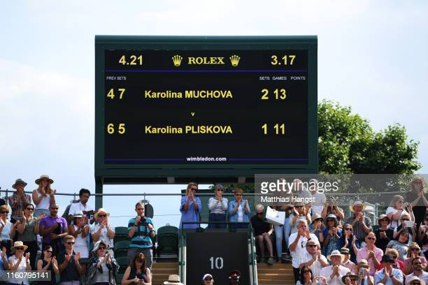 A view of a scoreboard inside court two during the Ladies' Singles fourth round match between Karolina Muchova of The Czech Republic and Karolina...