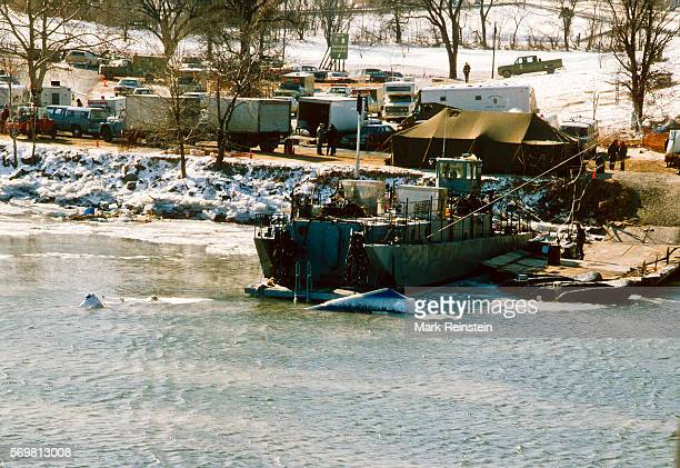 View of a section of Air Florida Flight 90 as it first breaks the surface to be lifted out of the Potomac River Washington DC January 20 1982 On...