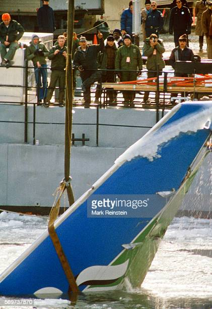 View of a section of Air Florida Flight 90 as it is lifted via crane out of the Potomac River Washington DC January 20 1982 On January 13 the plane...