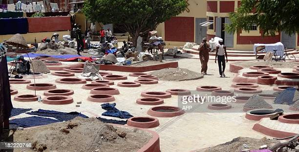 View of a section of the 500 years old Kofar Mata dye pits in the northern Nigerian city of Kano on September 8, 2013. The dye pits established in...