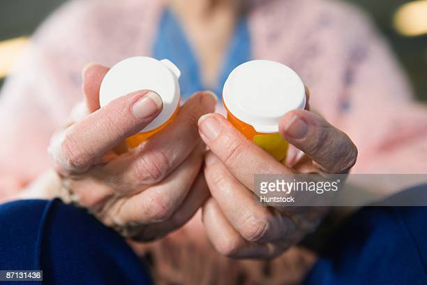 View of a senior woman holding medicines
