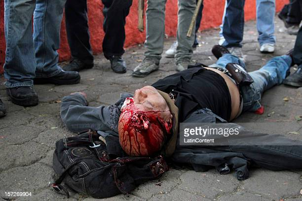 View of a seriously injured young man during the take of pocesion of President-elect Enrique Peña Nieto around the fence implanted by the Federal...