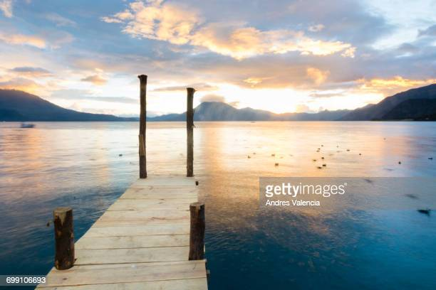 View of a setting sun from a dock in Panajachel, in the edges of Lake Atitla, Guatemala.